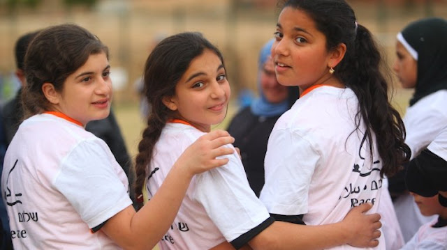 Israeli and Palestinian girls forming friendships